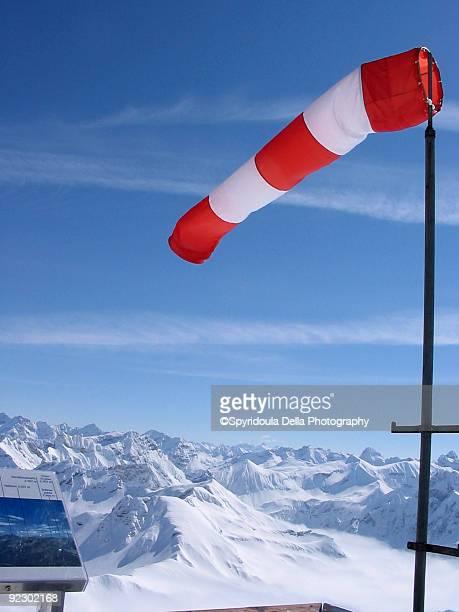 Windbag red white post ski mountains snowy stripes