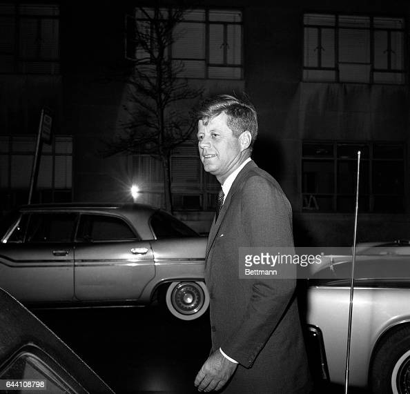 A windblown President Kennedy walks without a topcoat in brisk 40degree weather as he returns to the Hotel Carlyle in New York early Nov 5th The...