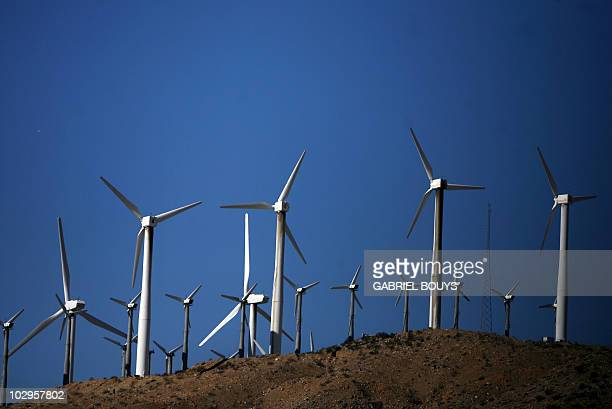 A windfarm is seen 30 December 2006 near Palm Springs California Increasingly popular as alternative sources of energy wind turbine generators are a...