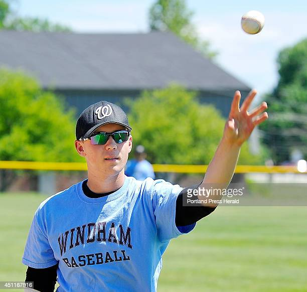 Windham baseball player Jack Herzig tosses balls to teammates during practice at Windham High School baseball field