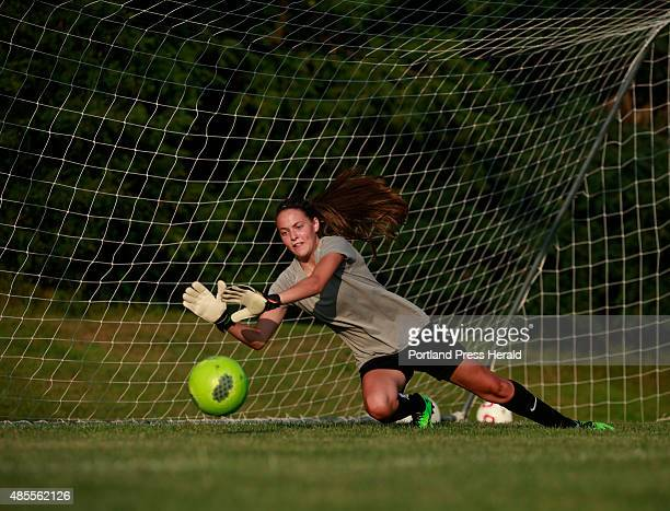 Windham high school girls soccer practice Sophmore goalie Kaitlyn Roberts dives to make a save during practice coach hasn't made a decision on...