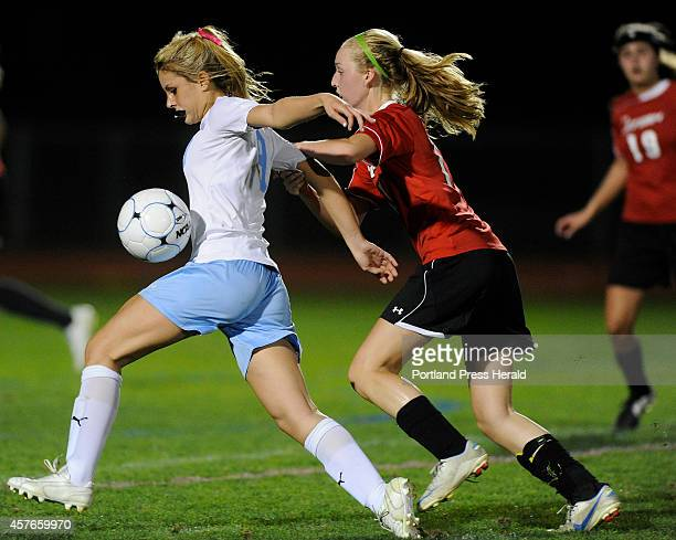 Windham High School versus Scarborough High School girls soccer game Windham Melissa Morton plays a high ball while pressured by Scarborough's Bryce...
