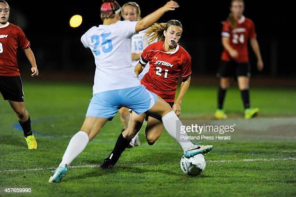 Windham High School versus Scarborough High School girls soccer game Scarborough's Katherine Kirk trys to get the ball past Windham defender Katie...