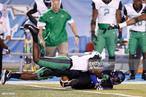 Windham of the Middle Tennessee Blue Raiders fumbles the ball in the second quarter of a game against the Marshall Thundering Herd at Floyd Stadium...