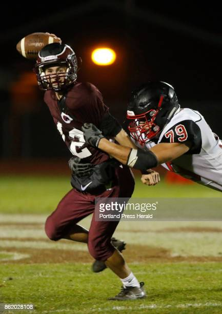 Windham QB Anthoney Gugliuzza is pressured by Scarborough linebacker Anthony Griffin during varsity football action on Friday October 6 2017