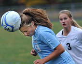 Windham's Sarah Rich heads the ball and BE's Desiree Wright gives chase as Bonny Eagle girls soccer hosts Windham HS