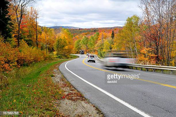 Winding highway during the autumn season with cars moving