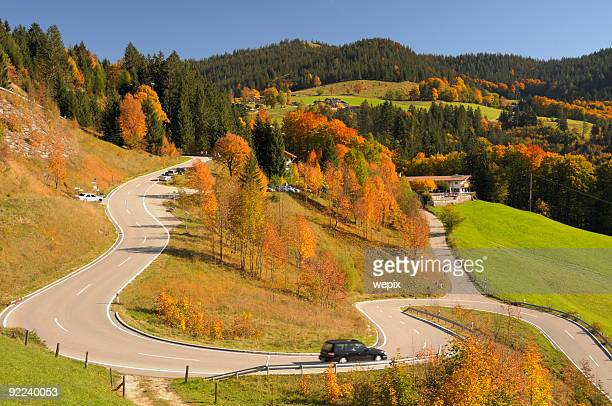 Winding mountain road colorful autumn landscape blue sky