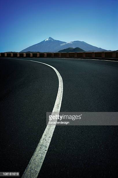 Winding Mountain Road with Teide Volcano in Background