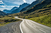 DSLR photo of a landscape with a winding mountain road with many curves in the austrian alps leading from Galtuer in Tyrol above the Silvretta Bielerhoehe to Vorarlberg. Nobody is on the street at thi