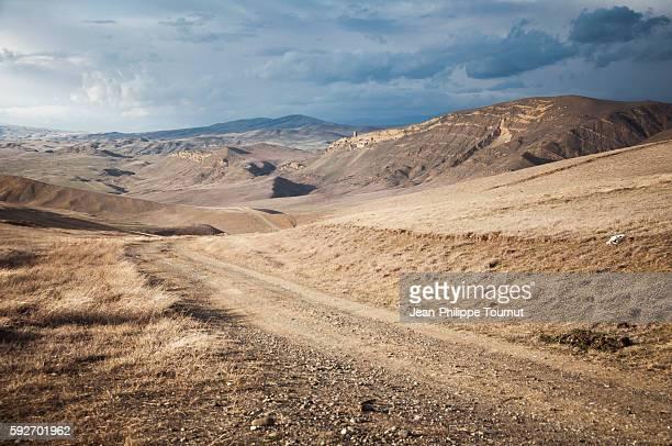 Winding road across the Georgian desert near David Gareja Monastery, Kakheti region, Eastern Georgia.