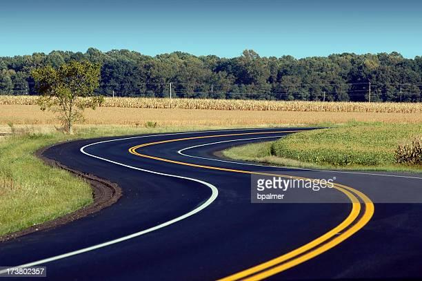 Winding road along countryside