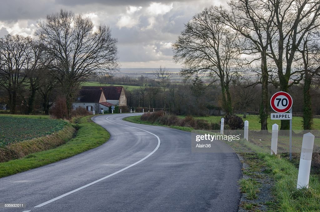 Winding road in wintertime : Stock Photo