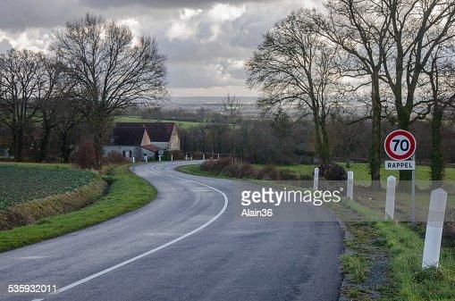 Winding road in wintertime : Stock Photo
