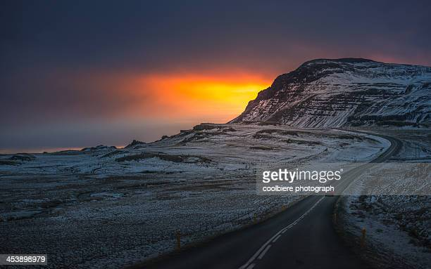 Winding road over sunset landscape of Iceland