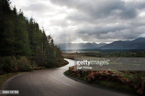 Winding road through mountains, Scotland, UK