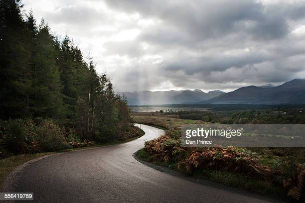Winding road through mountains, Scotland, UK