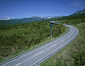 Winding road through scenic forest and mountains, Biei, Hokkaido, Japan