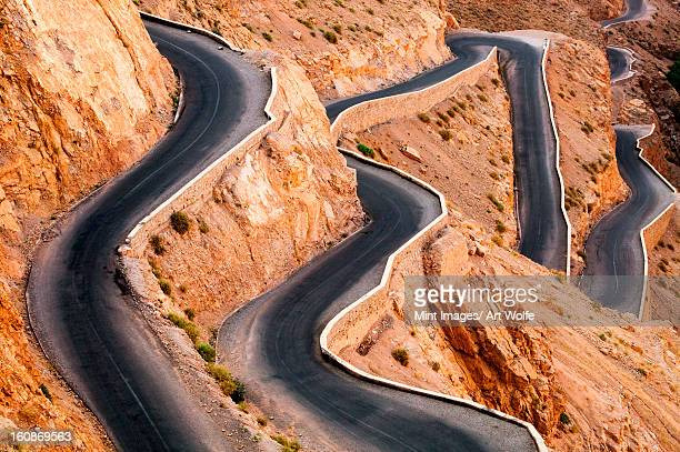 Winding road with hairpin bends up the rocky Atlas mountains from the Dades Valley, Morocco