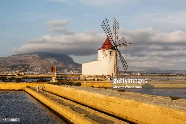 Windmill among salt flats, Trapani, Sicily, Italy