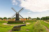 CONTENT] A windmill and a cannon in the star shaped fortress of Bourtange
