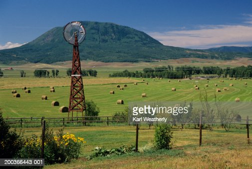 Windmill and haystacks on farm, Steamboat  Springs, Colorado, USA