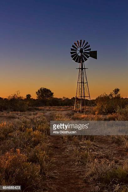 Windmill at sunset in the Kalahari - Kimberley South Africa