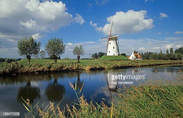 Windmill beside canal in Damme, Belgium.