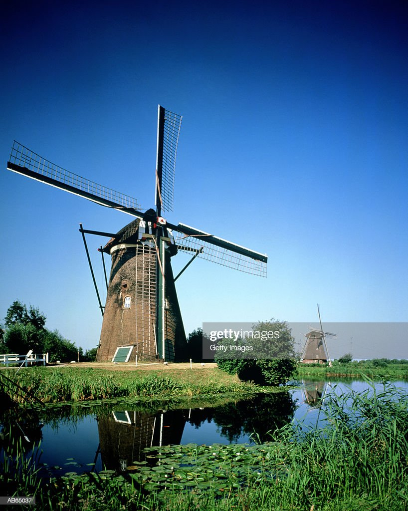 Windmill by stream, Netherlands : Stock Photo