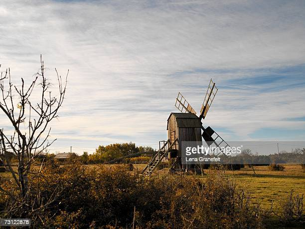 A windmill in deserted landscape.