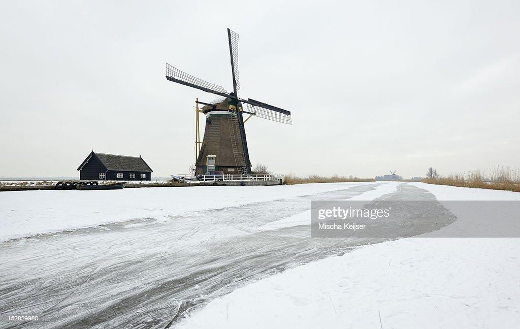 Windmill in snowy landscape : Stock Photo