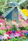 Windmill lawn ornament in a flowerbed