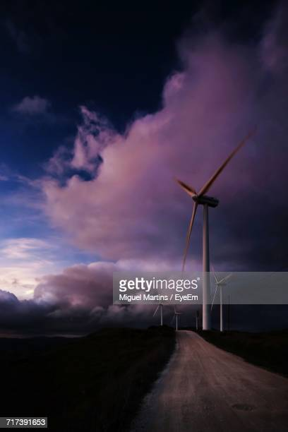 Windmill On Landscape Against Sky
