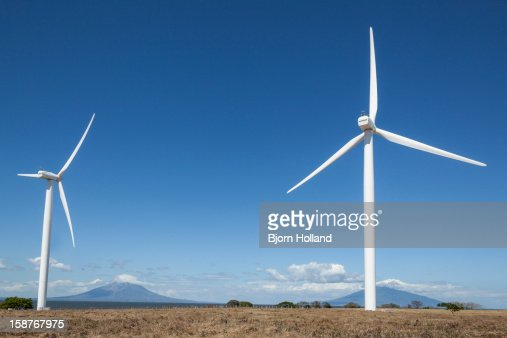 Windmill with volcano in the background : Stock Photo