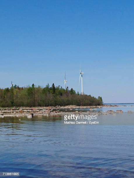 Windmills Against Clear Blue Sky