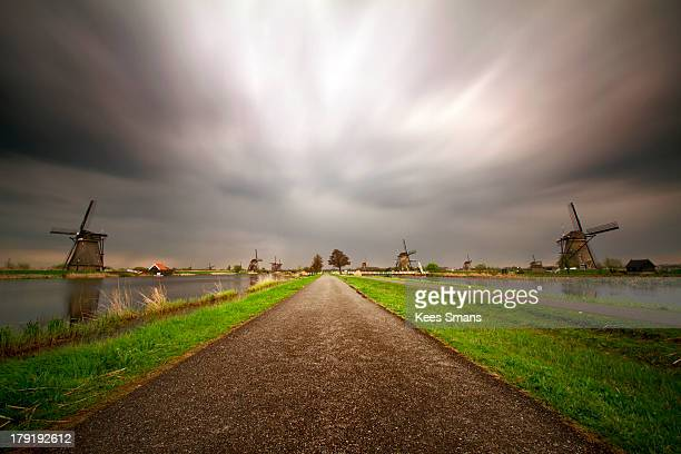 Windmills at Kinderdijk, moving clouds