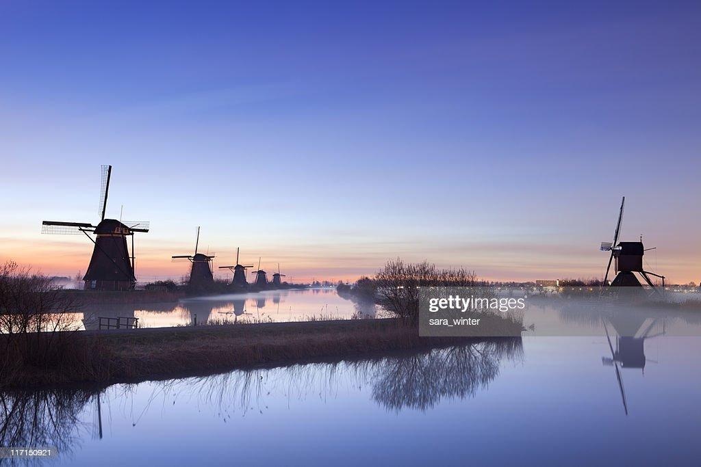 Windmills at sunrise : Stock Photo