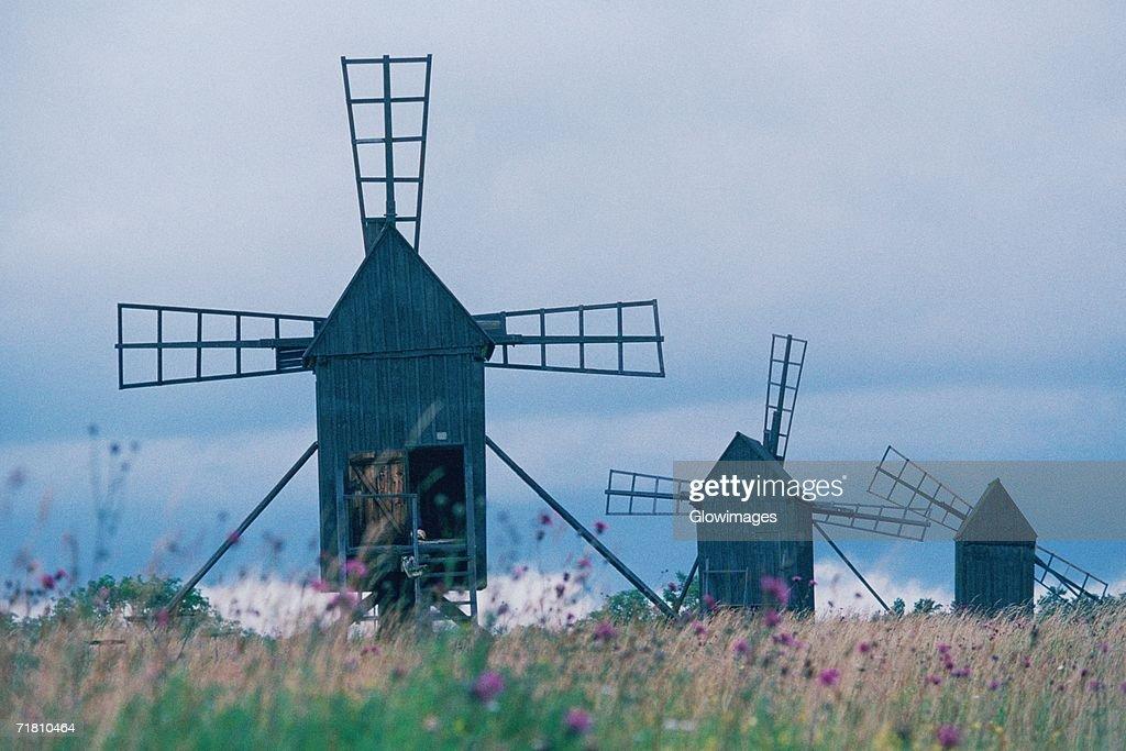 Windmills in a field, Oland, Sweden