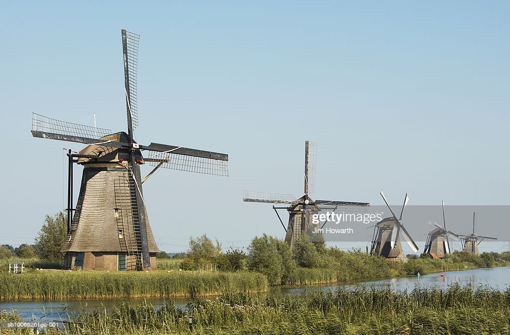Windmills of Kinderdijk, built in 1740 to drain the low catch-water basin located between the path and the mills,Holland : Stock Photo