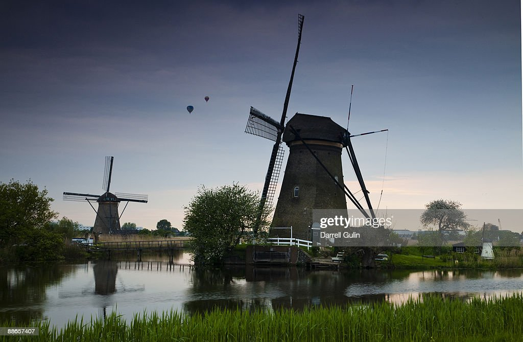 Windmills of Kinderdijk with hotair baloons  : Stock Photo