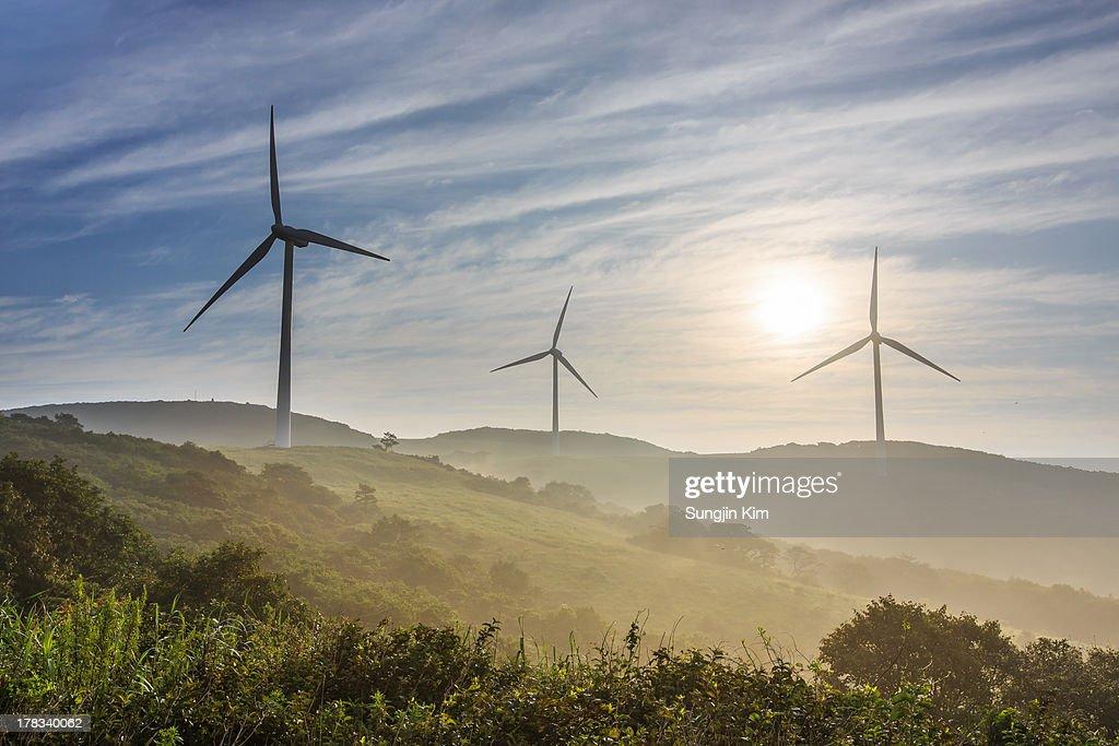 Windmills on the misty mountain