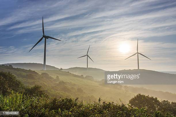 Windmills on the misty mountain