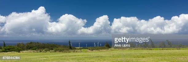 Windmills with cumulus clouds in North Kohala, Hawaii