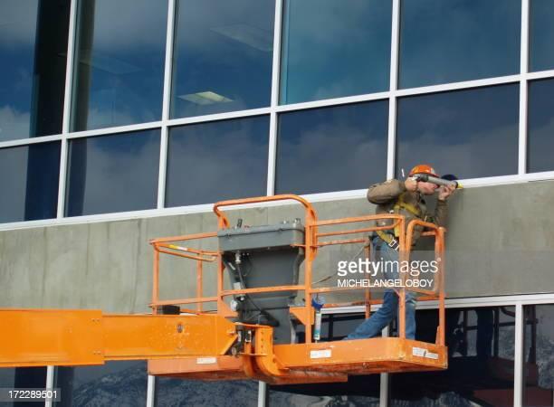 Window Caulking Construction Worker Man