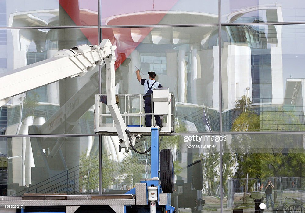 Window cleaner at the Paul-Loebe-Building, the chancellery in the back, August 17, 2006 in Berlin, Germany.