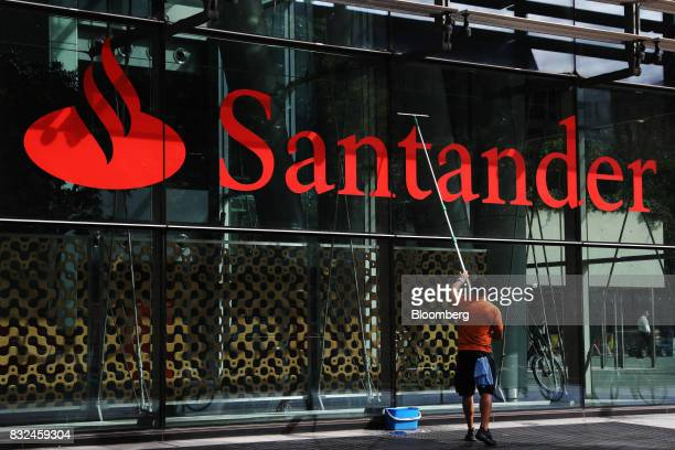 A window cleaner cleans glazing at the offices of Banco Santander SA in London UK on Tuesday Aug 15 2017 Banco Santander Spains biggest lender has...