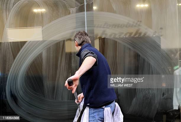 A window cleaner works on a shopfront in Melbourne on July 7 2011 as the Australian jobless rate came in at 49 per cent for a second month in a row...