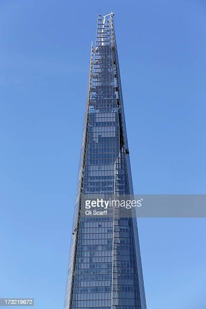 Window cleaners work on the 72storey Shard skyscraper which stands as the tallest building in Western Europe on July 10 2013 in London England...