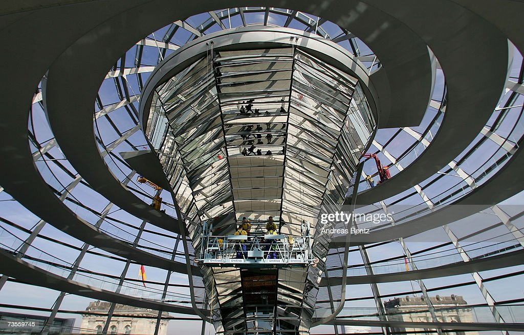 Window cleaners work on the Reichstag Dome on March 13 2007 in Berlin Germany Workers are preparing and cleaning the Reichstag for a public viewing...