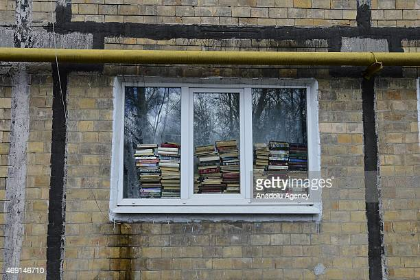 A window covered with books is seen in the eastern Ukrainian city of Donetsk on April 9 2015 The yearlong conflict in east Ukraine has affected...
